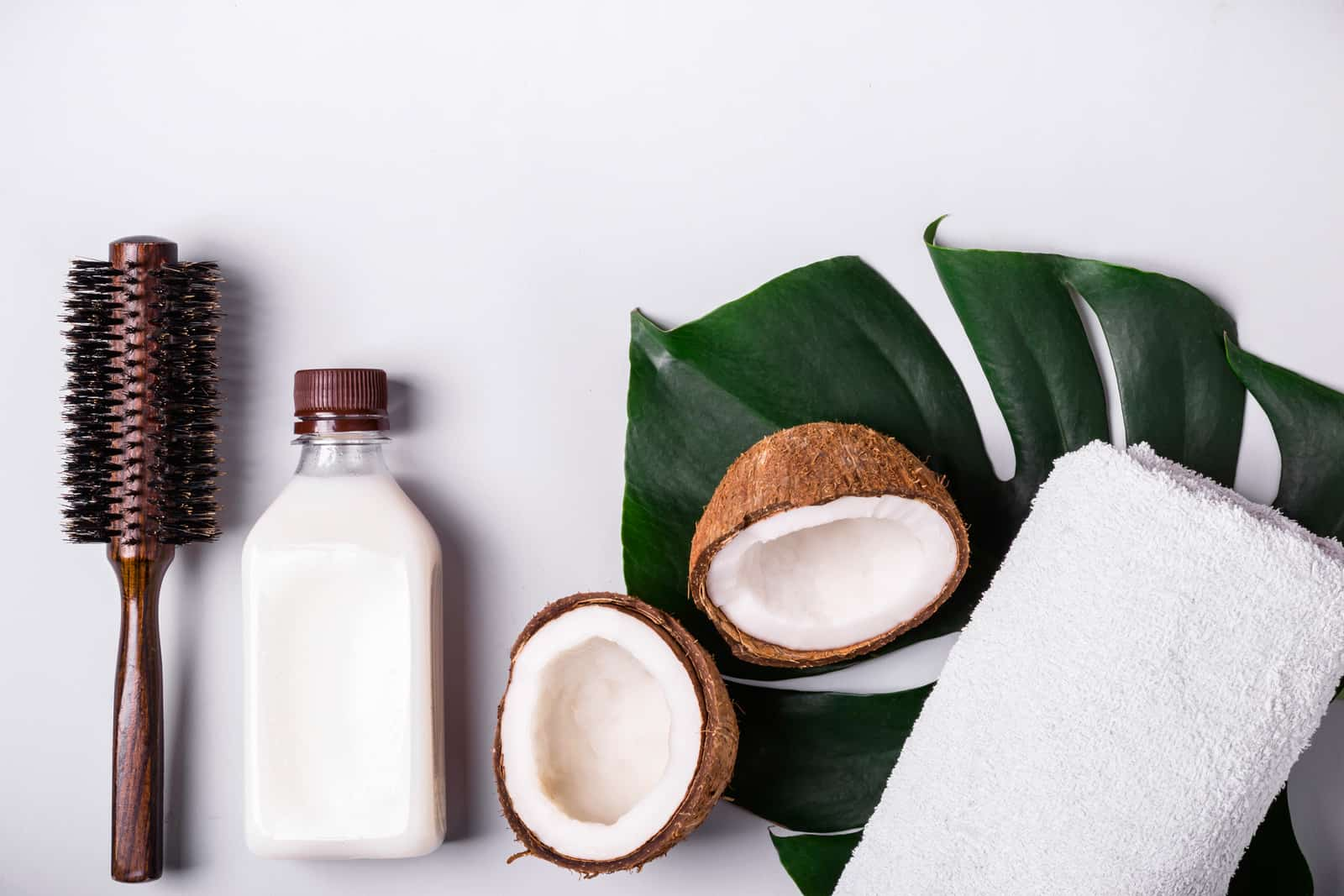 Coconut oil and tropical leaves. Hair care spa concept
